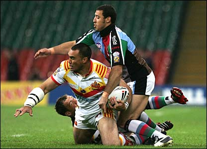 Alex Chan of Catalans is brought down by Danny Orr (L) and Paul Sykes