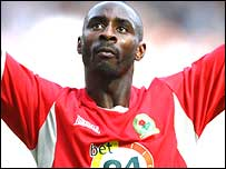Jason Roberts celebrates his goal for Blackburn