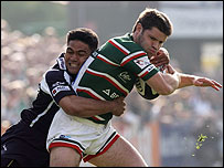 Leicester centre Dan Hipkiss is wrapped up by David Lemi of Bristol