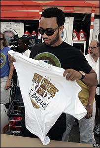 John Legend helps fold clothes at a temporary laundromat in New Orleans