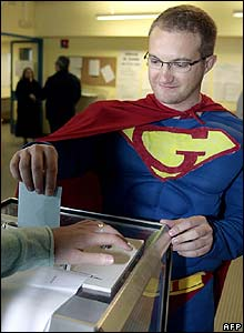 A man dressed as Superman casts his ballot in Toulouse, southern France