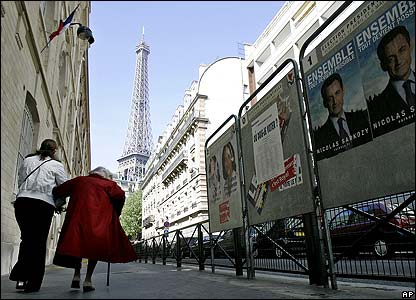 Women leave a polling station in the French capital, Paris
