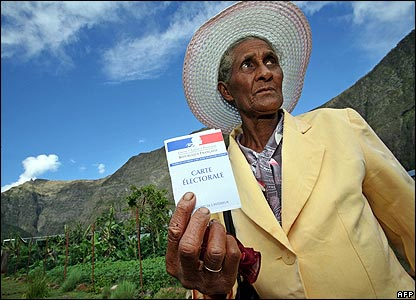 A man on the French Indian territory island of La Reunion prepares to vote