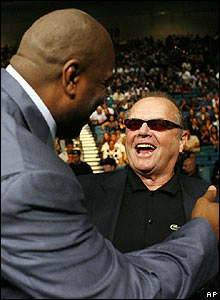 Jack Nicholson was greeted by former basketball great Magic Johnson