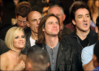 Actors Jim Carrey (centre) and John Cusack (right) with model and actress Jenny McCarthy.