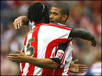 Leon Best [right] and Kenwyne Jones celebrate