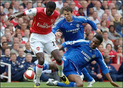 John Obi Mikel attempts to rob Emmanuel Adebayor of the ball