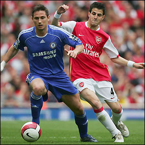 Lampard shields the ball from Cesc Fabregas