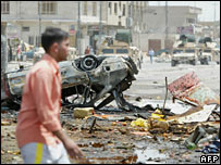 A man walks past the site of the blast in Bayaa