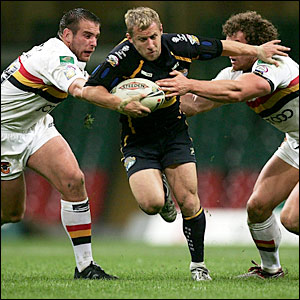 Rob Burrow bursts through a gap for Leeds