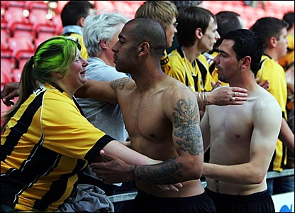 Boston United goal scorer Francis Green consoles the fans after their relegation to the Conference