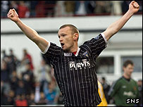Scott Wilson celebrates scoring Dunfermline's second goal