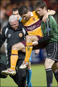 Paterson is helped off the pitch