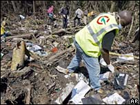 Rescuers at the crash site in Mbanga Pongo, Cameroon