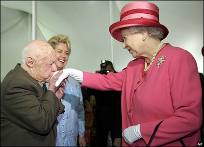Mickey Rooney kisses the Queen's hand