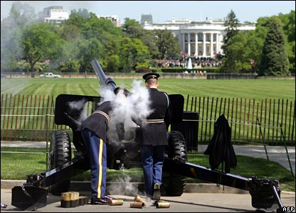 A member of the Presidential Salute Battery reloads a gun