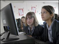 Girls looking at computer screen