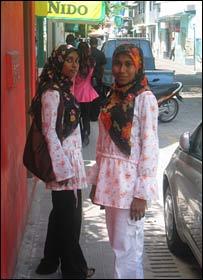 Young women in Islamic headscarves