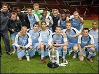 City reserves celebrate winning the Manchester Senior Cup