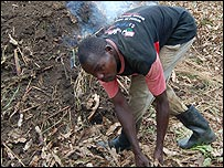 Richard Okello making charcoal