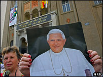 A woman in Sao Paulo holds a picture of Pope Benedict