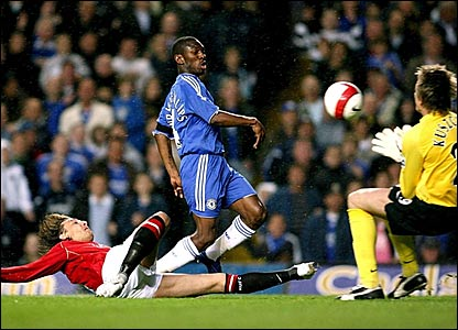 Gabriel Heinze (left) puts pressure on Shaun Wright-Phillips (centre) while Tomasz Kuszczak makes the save
