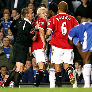 Manchester United's Alan Smith (second left) squares up to Jon Obi Mikel (centre) - Mikel is booked for a foul on Chris Eagles