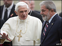 The Brazilian president greets Pope Benedict at Sao Paulo airport