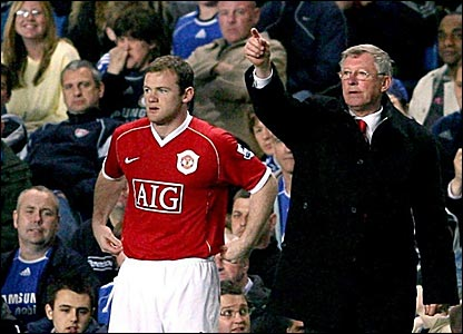 Wayne Rooney (left) is sent onto the pitch by Manchester United manager Sir Alex Ferguson