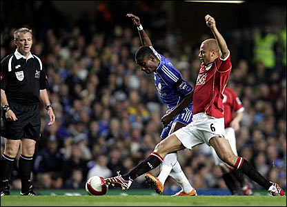 Chelsea's Salomon Kalou (left) is challenged by Wes Brown