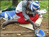 A Zimbabwean woman begs