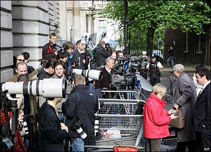 Photographers and journalists gathered in Downing Street