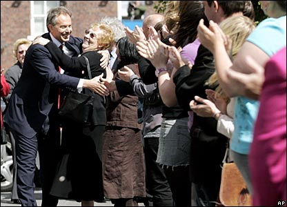 A supporter hugs Tony Blair