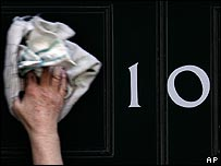 The door of Number 10 Downing Street being polished