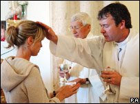 Kate McCann is blessed by Father Haynes Hubbard at a church service for missing Madeleine in Praia da Luz