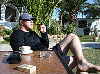 Roman Zykin relaxing with a cigar