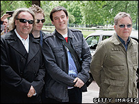 Peter Hook (L), Stephen Morris (second from right) and Bernard Sumner (R) of band New Order