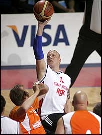 Great Britain's Andy Blake shoots for a basket