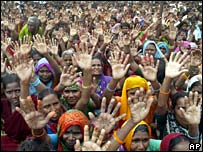 Bahujan Samaj Party supporters raise their hands at rally addressed by party leader Mayawati