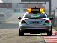 The safety car tests the track