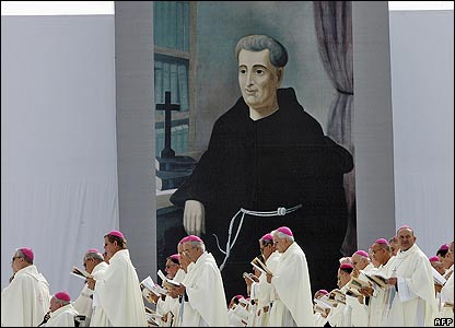 Archbishops stand in front of a painting of the Brazilian saint, Friar Galvao