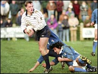 Scotland A's Gregor Townsend shrugs off challenges from Italy players in 1992
