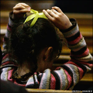 Girl with yellow ribbon
