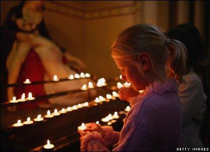 Girls lighting candles