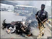 Karachi policeman amid debris after street violence