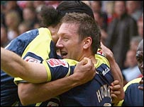 Steve Howard celebrates scoring for Derby