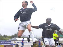 Jim McIntyre celebrates his goal at Caledonian Stadium