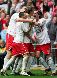 Steve Morison (centre) is mobbed by team-mates after scoring to make it 3-2