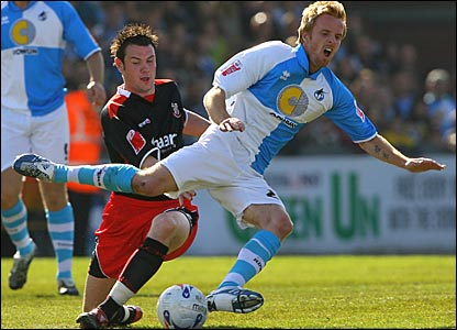 Lincoln City's Lee Beevers brings down Craig Disley of Bristol Rovers