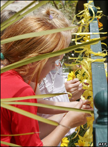 Yellow ribbons are tied for Madeleine
